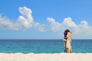 Romantic couple kissing at white sandy beach