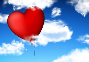 Red heart balloon in sky.