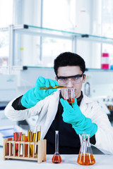 Scientist examining chemical sample