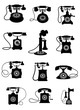 Silhouette of vintage telephones - 77298338