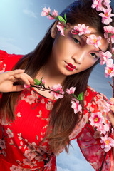 Beautiful woman with blooming peach tree
