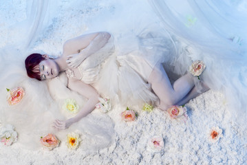 Sleeping beauty in white winter scenery