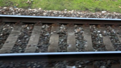passing rails on a railroad track from train