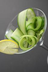 Fresh cucumber stripes in a martini glass.