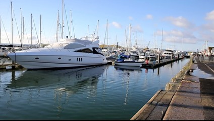 Poole harbour and quay Dorset England UK with yachts and boats
