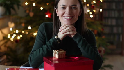 Portrait of beautiful girl with christmas gifts