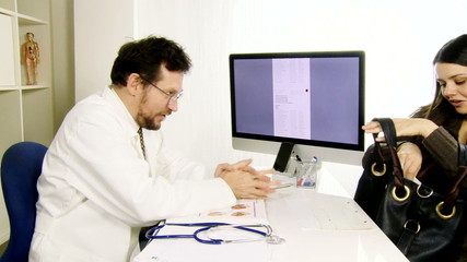 Doctor giving good news to happy female patient