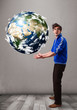 Good-looking man holding 3d planet earth