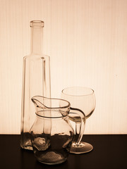 Old glassware silhouetted, tinged brown antique effect.