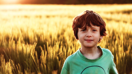 Boy inbetween the fields