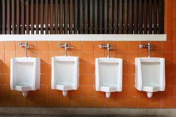 decor interior of white urinals in men bathroom toilet