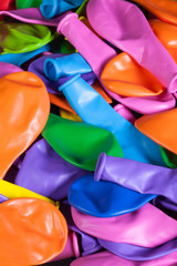 Colorful deflated balloons on the desk