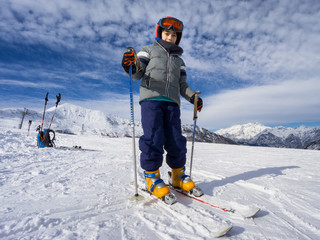 Skiing, portrait of young kid skier on ski slope