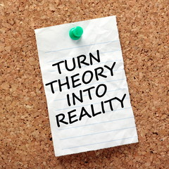 The phrase Turn Theory into Reality on a notice board reminder