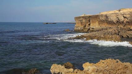 waves of the Atlantic Ocean break about coastal rocks