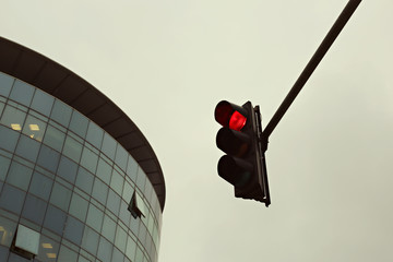 Red traffic light in the city
