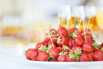 plate of fresh ripe strawberries