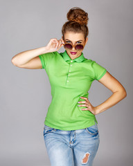 Girl in T-shirt, jeans and sunglasses