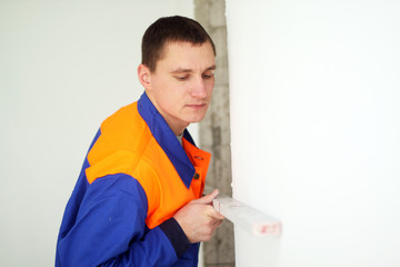 Young worker with level