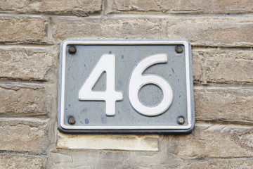 Number forty-six on the wall of a house