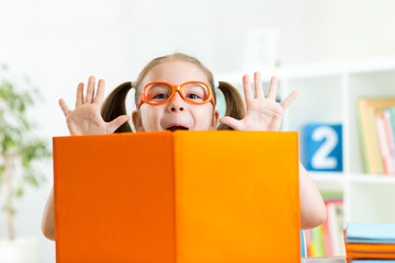 funny kid girl weared eyeglasses with book