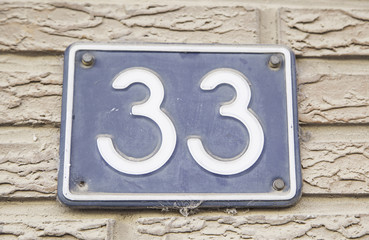 Number thirty-three on the wall of the house