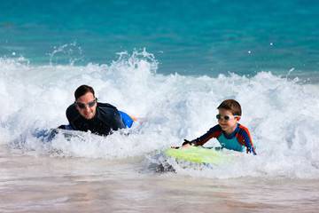 Father and son boogie boarding