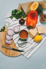 Cooking ingredients, vegetables and cheese on the cutting desk,