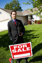 Home: Agent with For Sale Sign