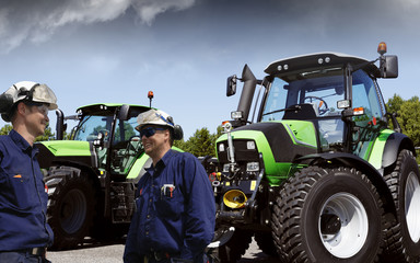 mechanis, workers with large farming tractors, latest models