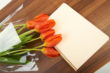 Red tulip flowers on the table, background