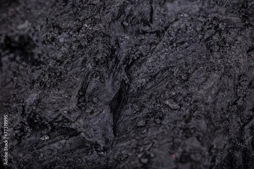 Coal lumps on dark background - 77319995