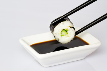 Sushi (Roll) on a white background