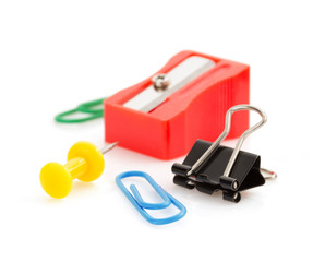 pushpin and paper clip on white background