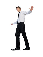 Business man walking on imaginary rope