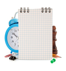 notebook and school supplies isolated on white