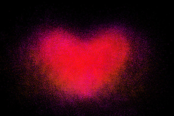 Freeze motion of heart shaped red powder