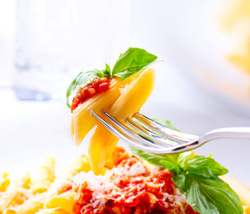 Pasta. Penne Pasta with Bolognese Sauce on a Fork