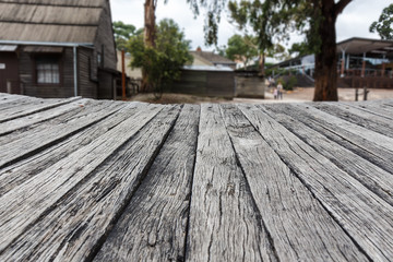 Empty wooden table with village background