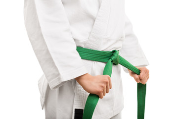 Young girl tying her karate belt