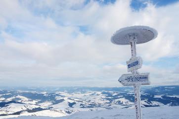 Frozen direction sign at Gimba mountain,winter time,Carpathians
