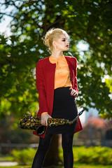 girl with saxofon on street
