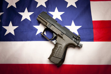 Concept of pistol on the flag.