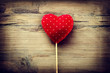 Valentines vintage handmade heart over wooden background