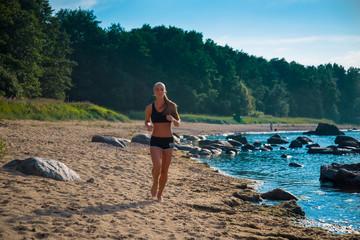Running woman. Female runner  workout on beach.