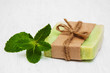 Homemade soap  with fresh mint leaves - 77326533