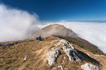Mountain landscape above the clouds