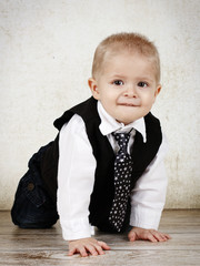 Funny little toddler with tie