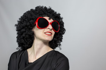 Red lipstic women wearing a black wig posing