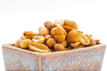 Salted peanuts in a small bowl